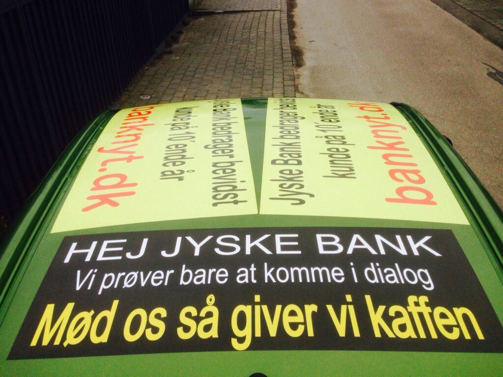 """Den Danske Bank JYSKE Fight against a criminal DaThe catfish in Jyske Bank bank, also known as the Green Butcher  Is pleased with all questions, and agrees that Dialog is the way forward, but that is not what the bank's customers get to feel when Jyske bank exposes them to fraud.nish bank  Follow the little man's battle against Denmark's second largest bank, which continues to cheat the customer.  But now the customer gets the case for court, after 11 years of fraud, a case there was launched in 2013 as Ref. 328/2013 in the Danish Complaints Board, and then into court 2015. as case BS-402/2015-VIB """"BS 1-698/2015"""" Viborg cort.  /  An extremely burdensome cause to be the victim of, the bank Jyske bank does not care, this kind of small criticism does not have any significance for the bank  / /  And what is the customer shouts about ?, as the bank is so cold facing  A case against large Danish bank, for rough document false and fraud  Fraud which the district attorney refused to investigate, and #jyskebank themselves refuses to stop  Moving in to the court for a judgment. September 30, 2019  /  The Executive Board of the large Danish banks is rewarded, to earn income and that without the shareholders like ATP. A P Møller asks questions  See and share this illustration: https://facebook.com/jyske.bank.bedrager.kunde/photos/a.1124471997636950/1185935418157274/?type=3&source=54  /  The court offers to meet and talk about the problem, and there is nothing we rather would.  We have ourselves presented a series of appendices, for Annexes 100 and 101.   And only want the jyskebank group, the bank's board of directors  Admits what we already have provided proof of, so it is actually quite a simple matter.  /  We have since May. 2016 tried to enter into a dialogue, with jyske bank CEO Anders Dam, who consistently refuses to talk to us.  We ourselves as a customer have tried dialogue, but the bank refuses, and block us on social media so we can't even follow the bank  /  We are s"""